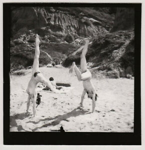 Original-vintage-1970s-male-and-female-nude-doing-gymnastics-contact-print