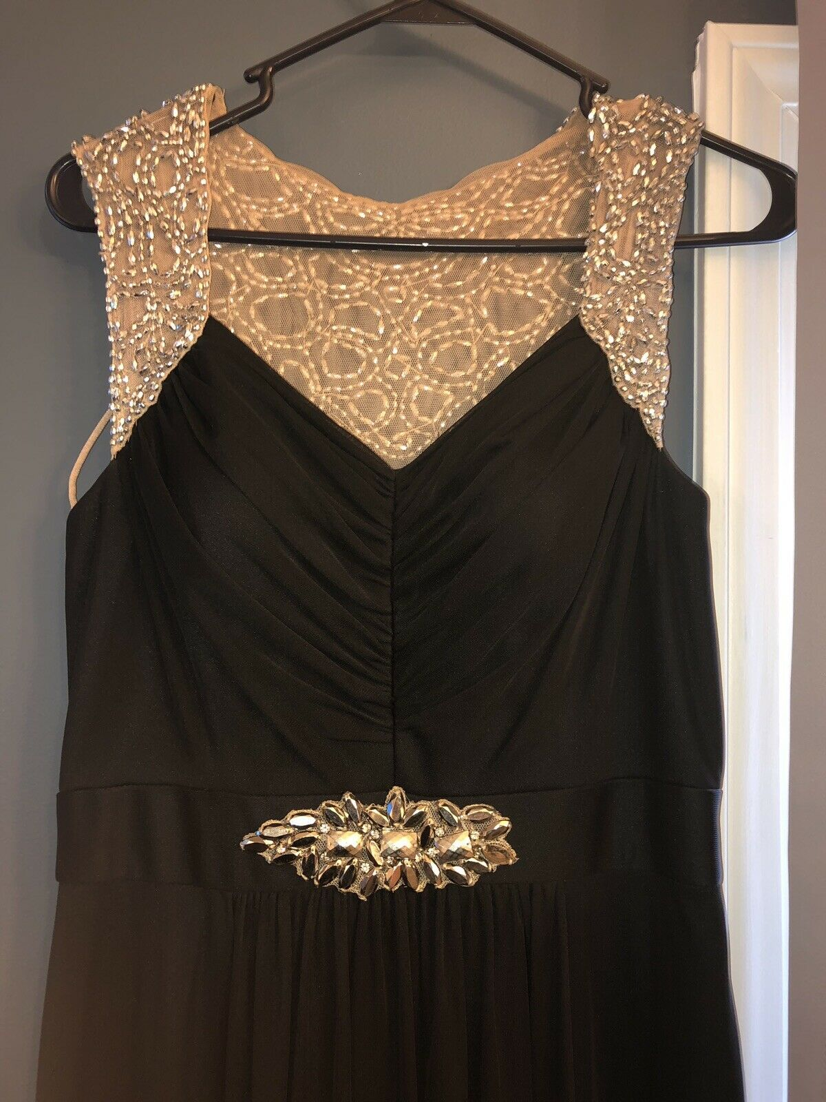 Betsy & Adam Size 8 Evening Dress with very nice beading. Gently used one time.