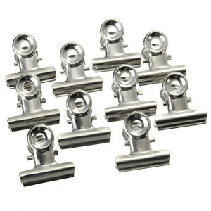 '10Pcs-Mini-Bulldog-Letter-Clips-Stainless-Steel-Silver-Metal-Paper-Binder-Clips' from the web at 'https://i.ebayimg.com/images/g/6SkAAOSwuspY-sem/s-l300.jpg'