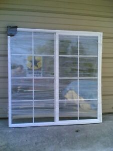 Brand new big white vinyl house slider window with grids for Home window brands
