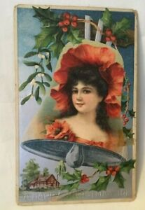 1908-Embossed-Christmas-Postcard-A-HAPPY-CHRISTMAS-TIDE-girl-in-bell