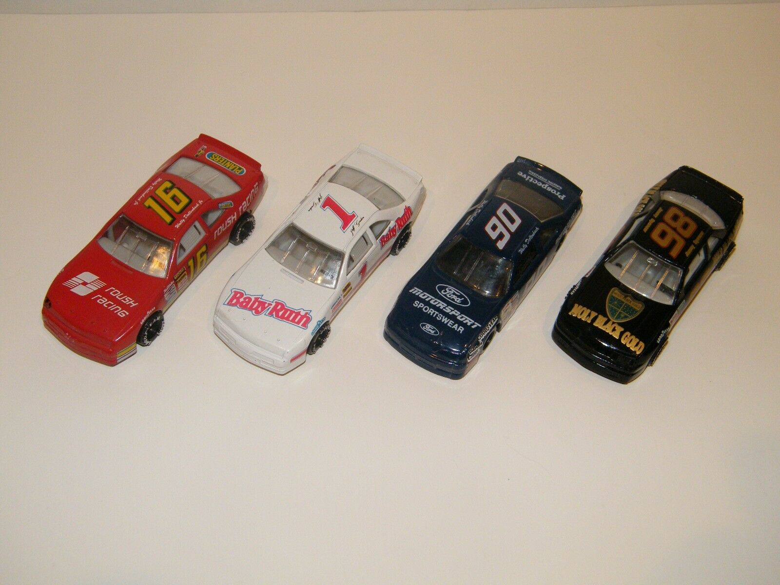 (4) NASCAR 4-1 2  RACE CARS  BABY RUTH, PLANTERS, MOLY MAX gold, MOTORSPORT