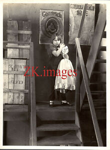 LE-P-039-TIT-PARIGOT-Film-Enfant-Poupee-Pneu-Goodrich-1926