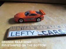 1995 ORANGE TOYOTA SUPRA THE FAST AND THE FURIOUS SCALE 1/64 (YEAR: 2012) LOOSE!
