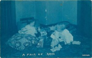 C-1908-Cyanotype-RPPC-Two-Children-with-Toys-real-photo-postcard-8975