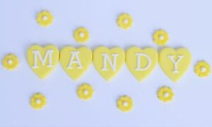 Edible name cake topper and edible daisy flowers Edible name cake topper