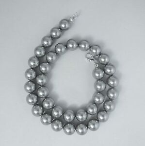 Grey blue pearl necklace with lampwork leaves and silver elements