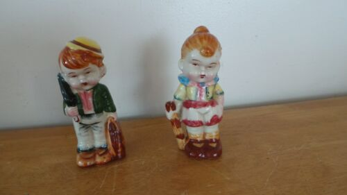 Vintage Pair Of Figurines Boy With Umbrella and Girl Red Hair