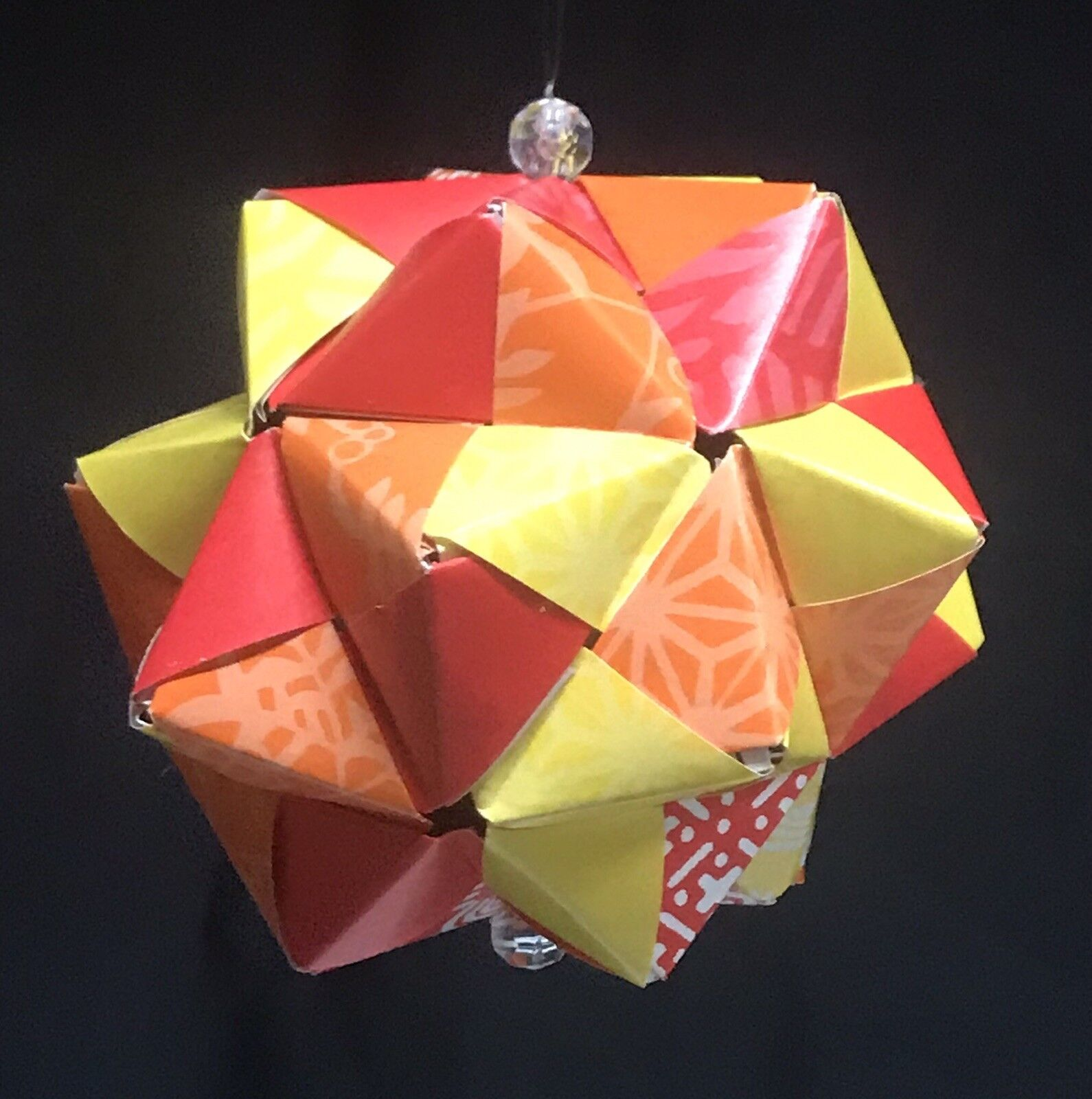 He Folds Paper Squares To Make An Impressive Origami Icosahedron | 1600x1590