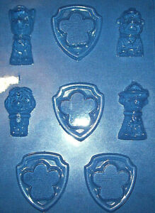 FOUR-PAW-PATROL-CHARACTERS-AND-FOUR-SHIELDS-CHOCOLATE-MOULD-OR-PLASTER-MOULD