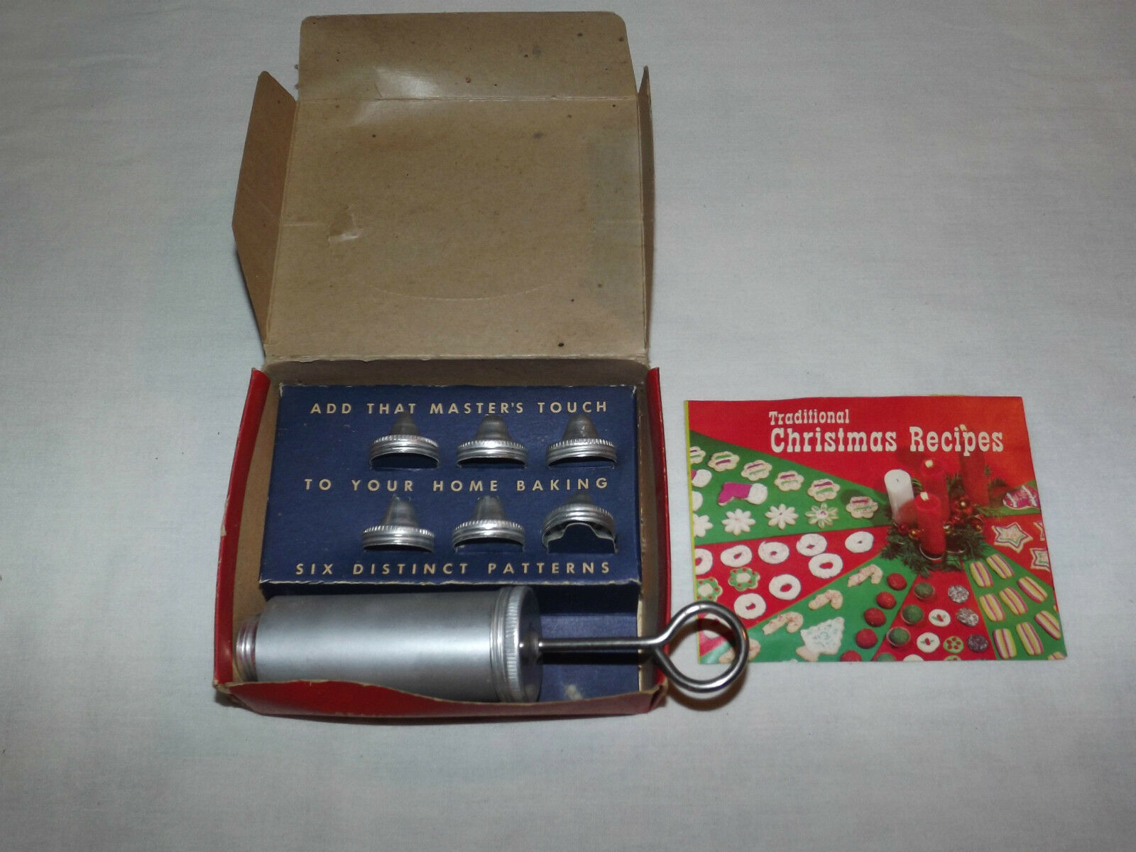 VINTAGE 1960S LORRAINE ALUMINUM CAKE DECORATOR IN BOX with CHRISTMAS RECIPES