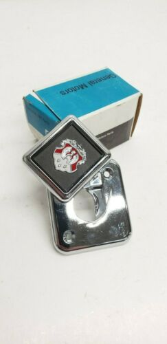 20524501 OEM NOS 1985 Oldsmobile 98  Regency Brougham Trunk Lock Cover Emblem GM