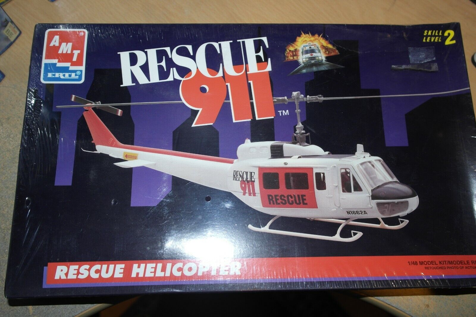 AMT   ERTL 1 48 BELL HUEY RESCUE HELICOPTER 6400