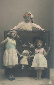 VINTAGE REAL PHOTO of 3 CHILDREN & GERMAN PORCELAIN DOLL POSTCARD - UNUSED