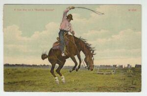 "[70517] OLD POSTCARD ""A COW BOY on a BUCKING BRONCO"""
