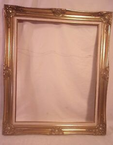 Vintage gold photo frame holds a 2 x 3 photo
