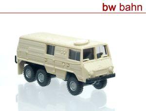 Roco-miniatur-modell-H0-1706-Steyr-Puch-Pinzgauer-6x6-Kastenwagen-beige-Neu