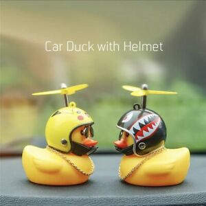 Rubber duck with helmet for car and bicycle