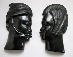Paire-de-Bustes-Africains-Anciens-en-Ebene-Bois-Noir-Sculpte-Homme-Femme-Mural