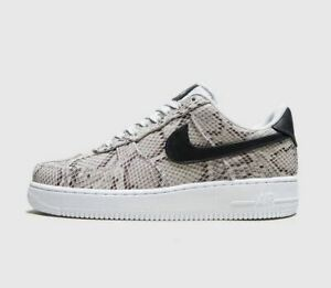 nike air force 1 trainers in white snakeskin