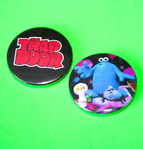 Set-of-2-Childrens-TV-Show-Trap-Door-button-pin-badges
