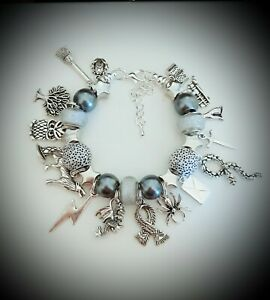 Charm bracelet with 5 silvergrey coloured charms