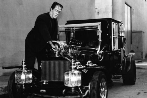 Fred Gwynne Tuning Up The Munster Car In The Munsters 11x17 Mini Poster