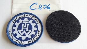 THW-Armabzeichen-Rund-70mm-gewebt-weiss-auf-blau-1-Stueck-mit-Klett-c236
