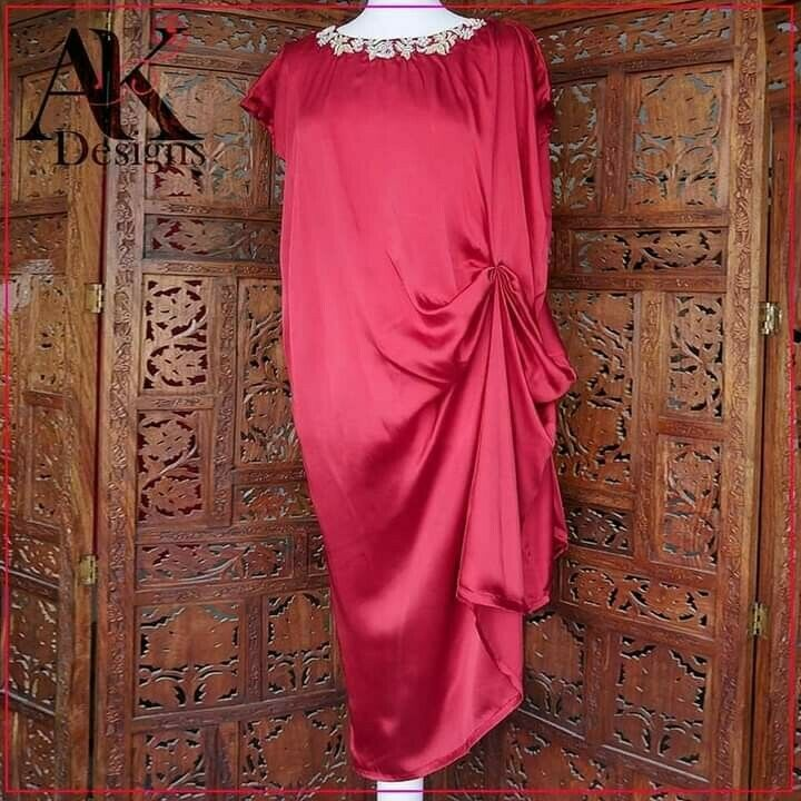 Red knotted caftan embellished with pearls and handwork. To fit xs to m