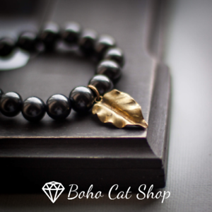 Shungite bracelet with gold leaf pendantEMF protection chakra balancing