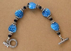 MILLEFIORI-GLASS-BEAD-HOPE-BRACELET-SILVER-TONED-SPACERS-amp-FACETED-BLACK-BEADS