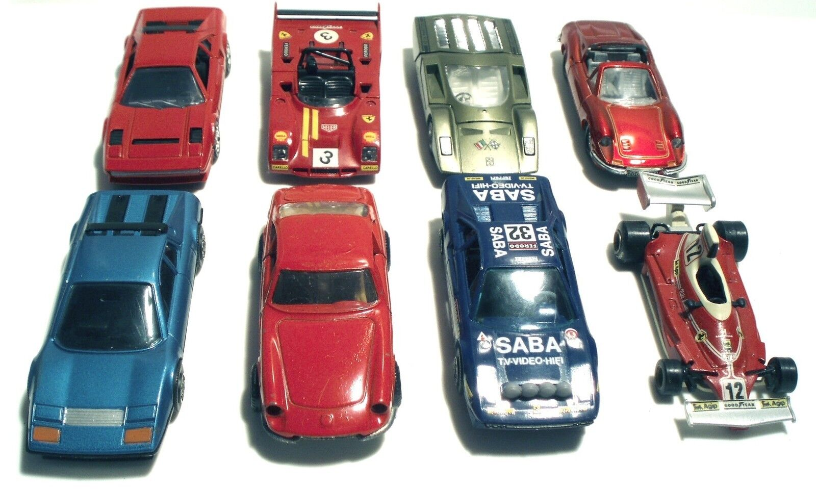 Lote 4 de 8 Ferrari por Burago, Super Campeón, Hot Wheels, Jet Auto De Norev, etc.