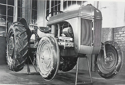 """12 By 18"""" Black & White Picture Ford Tractor 9N shown with jack stands"""