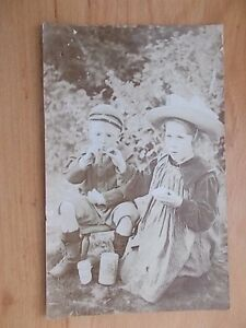 VINTAGE-1909-POSTCARD-CHILDREN-SMOKING-A-PIPE-CHARD-SOMERSET-RP