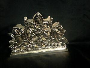 Porte courrier ajouré en bronze argenté à décors d'angelots