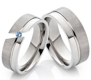 2-Verlobungsringe-Eheringe-aus-Titan-mit-echtem-Blautopas-Ring-Gravur-TD2T