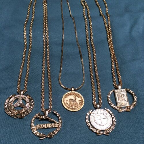 1970s shiny gold plated Mercedes medallion on chain