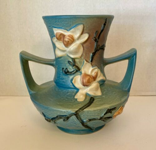 Blue raku ceramic ear clip.