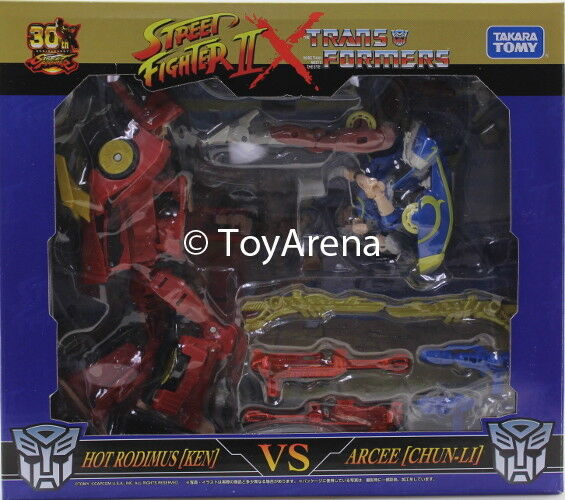 Ahorre hasta un 70% de descuento. Takara Transformers X Chun-Li de Street Street Street Fighter II (arcee) vs. Ken (Hot Rodimus)  promociones de descuento