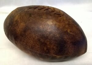 leather effect rugby ball or american football door stop juliana