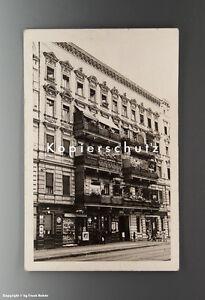Ansichtskarte-LADEN-mit-EMAILSCHILDERN-um-1920