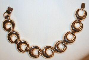 Raised-Goldtone-Horseshoe-Crescent-Bangle-Bracelet