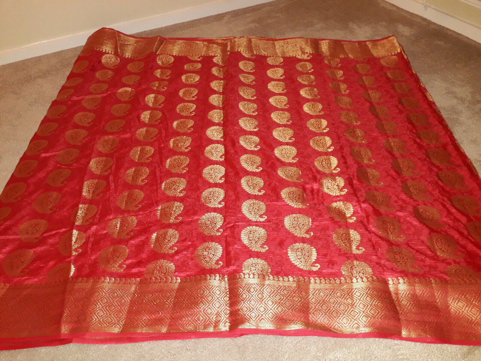 Pink Coloured Saree with gold khattan patterns (Matching blouse provided)