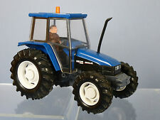 BRITAINS MODEL No.9487 NEW HOLLAND 6635 TRACTOR & DRIVER