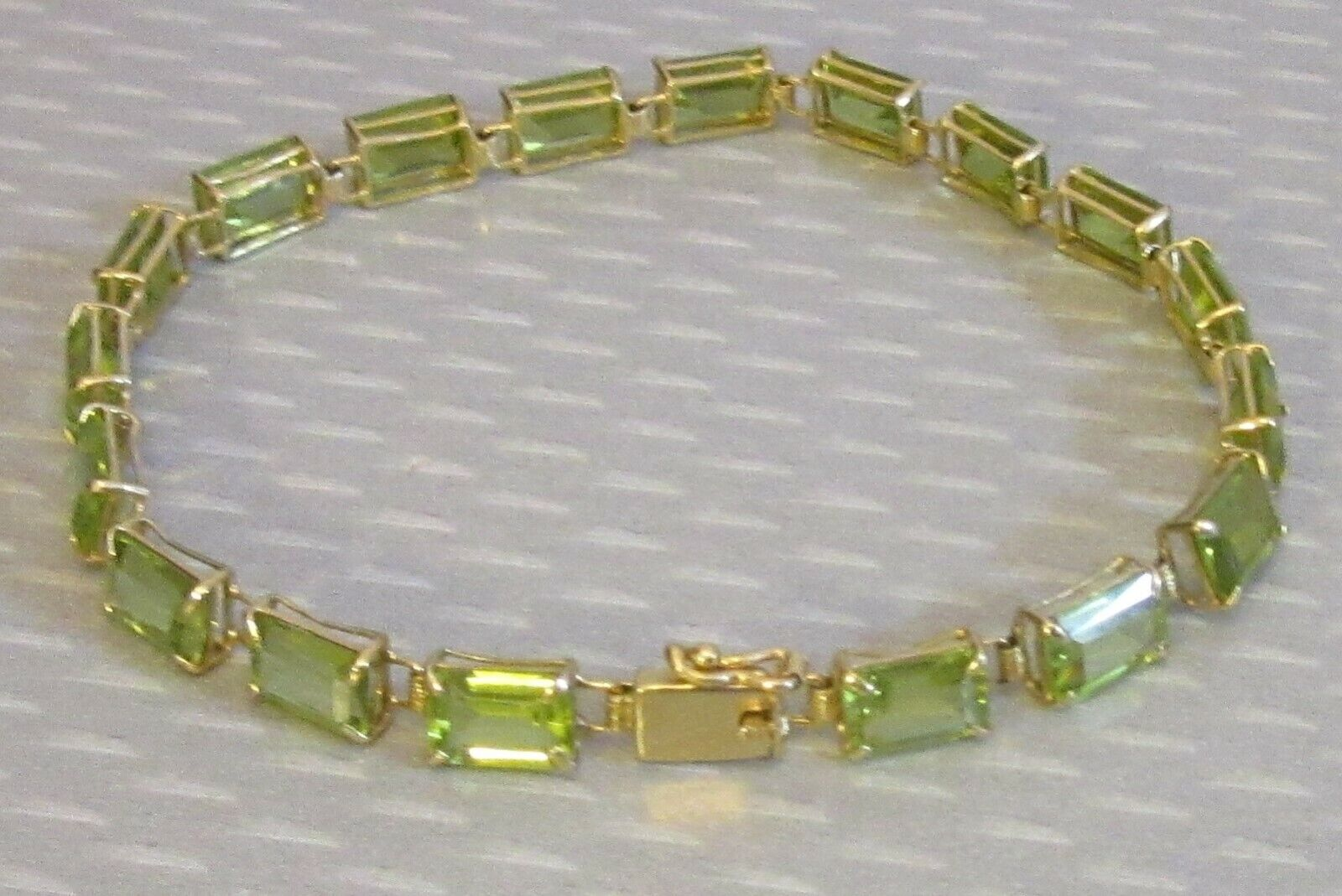 14K yellow gold PERIDOT TENNIS LINE BRACELET 12ct emerald cut green gems 7