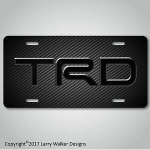 TRD-Toyota-Black-Acrylic-on-Carbon-Fiber-Look-Aluminum-License-Plate-Tag-New