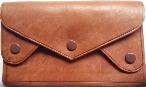 Handmade high quality compact coloured leather wallet with 4 compartments.