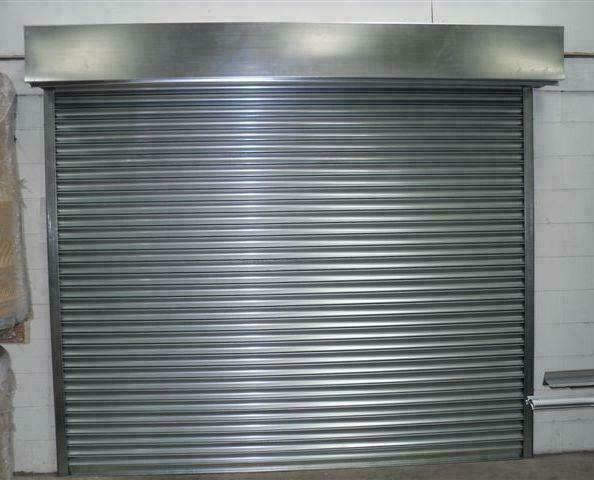 ELECTRIC doorway roller shutter 1000mm wide x 2200mm high INCLUDING CANOPY