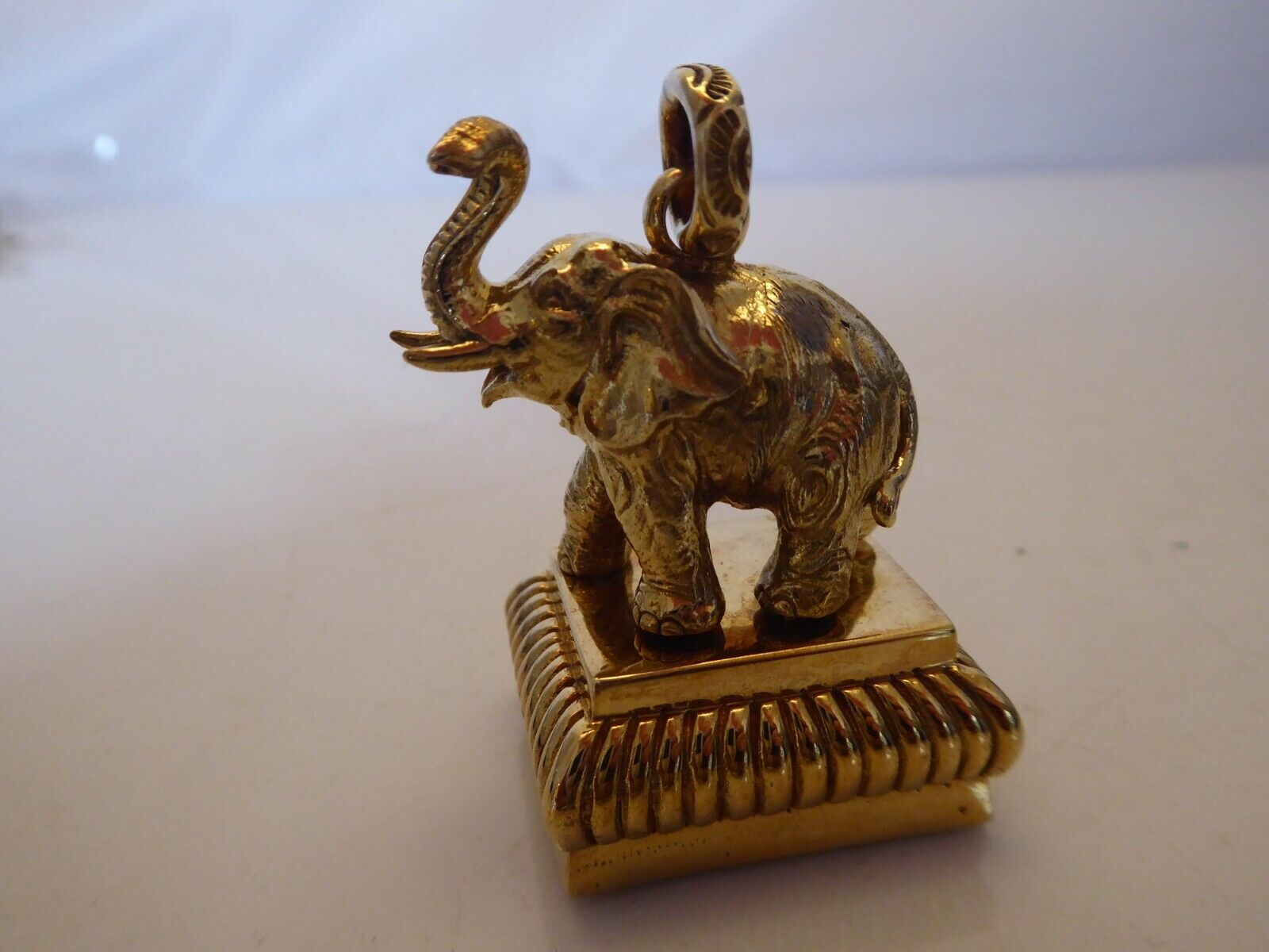 GILDED SEAL IN FORM OF A STANDING ELEPHANT.