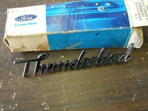 NOS 1977  Ford Thunderbird Headlamp Door Emblem Script